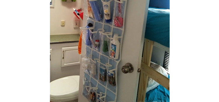 organize your rv bathroom, picture of a shoe organizer hanging on a rv bathroom door for a organization device