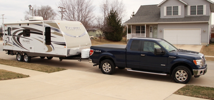 how to tow a bumper pull trailer, picture of a truck with a travel trailer hitched getting ready to go camping